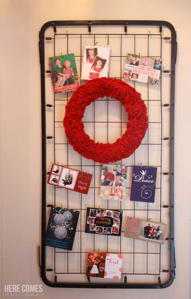 Use an old crib spring for a Christmas card display. Genius!