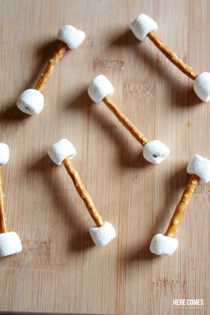 Chocolate covered pretzel and marshmallow bones recipe. An easy and spooky treat!