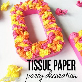 This tissue paper party decoration looks like real flowers but is sooo much cheaper to make!