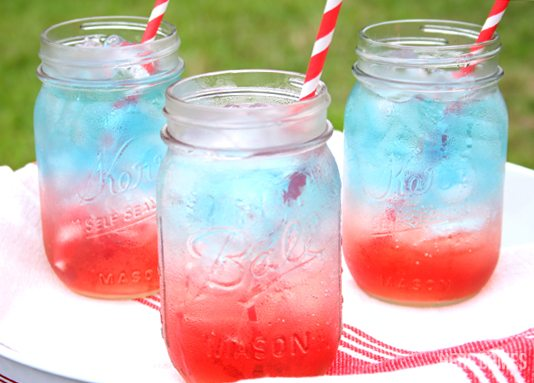 This red white and blue layered drink looks spectacular and is the perfect addition to your Memorial Day or July 4th celebrations!