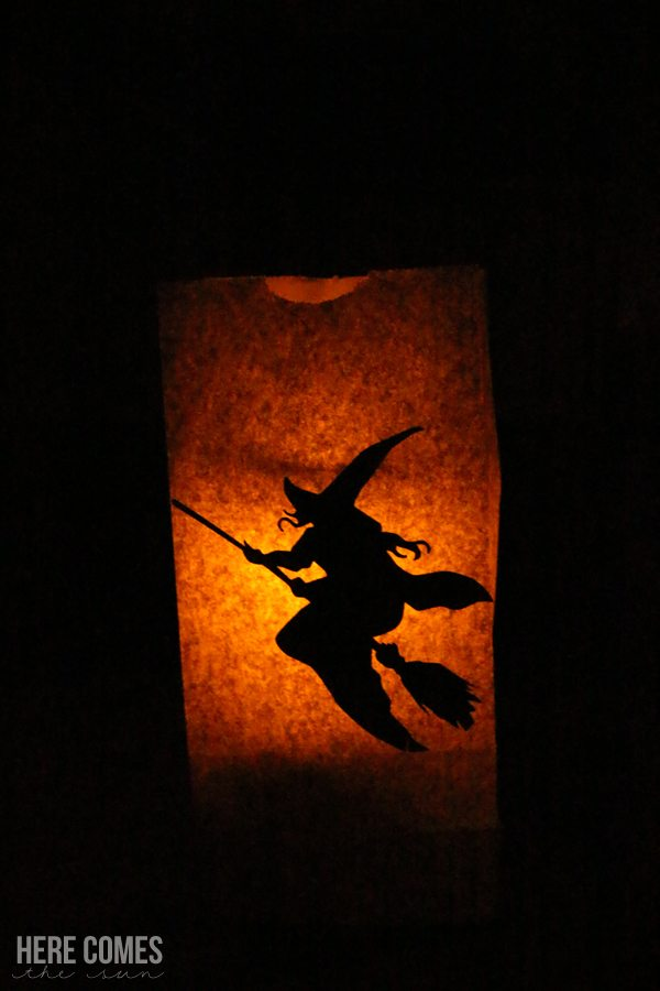 These Halloween paper bag luminaries are easy to make and look fantastic at night. Create your own with this easy tutorial.