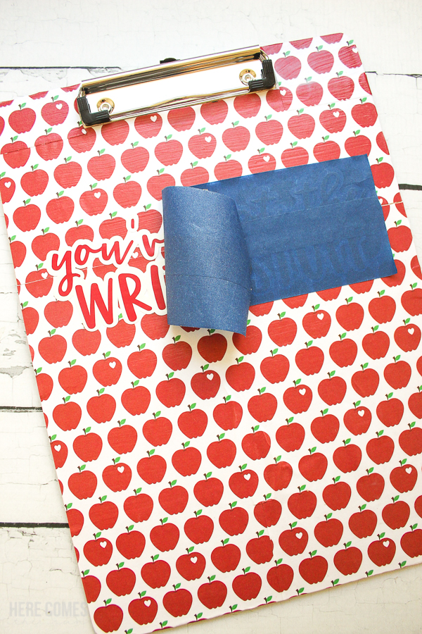clipboard teacher gift decorated with scrapbook paper and vinyl