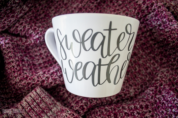 hand lettered fall mug on sweater background
