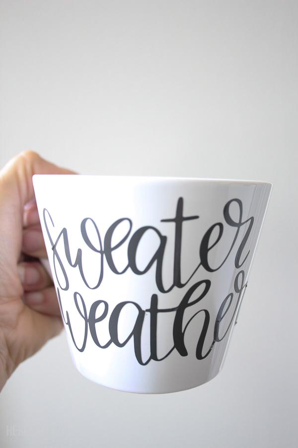 hand holding hand lettered fall mug