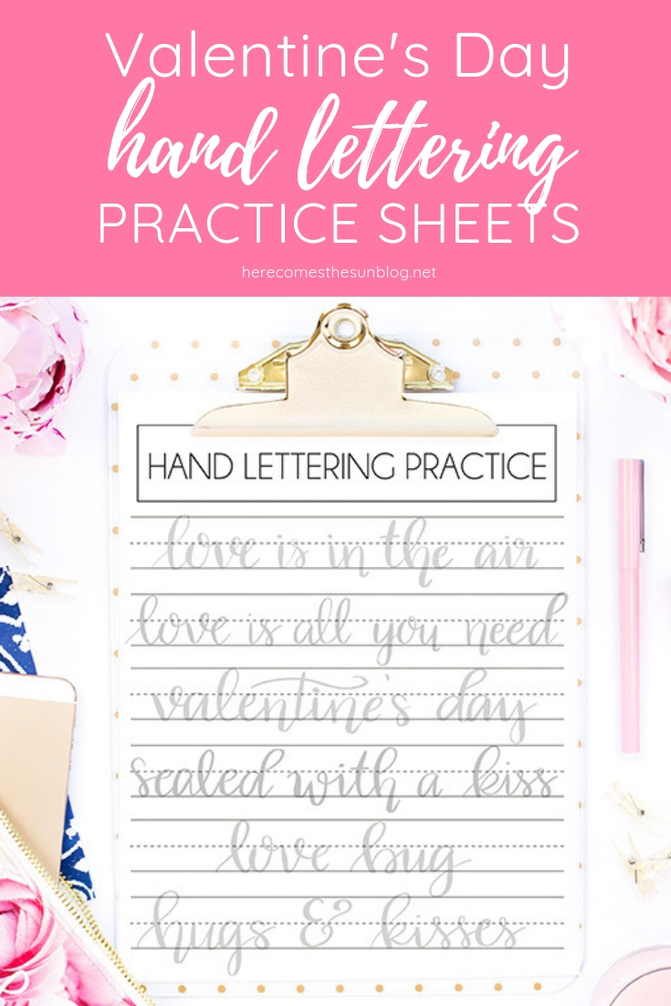 valentines day hand lettering practice sheets on clipboard