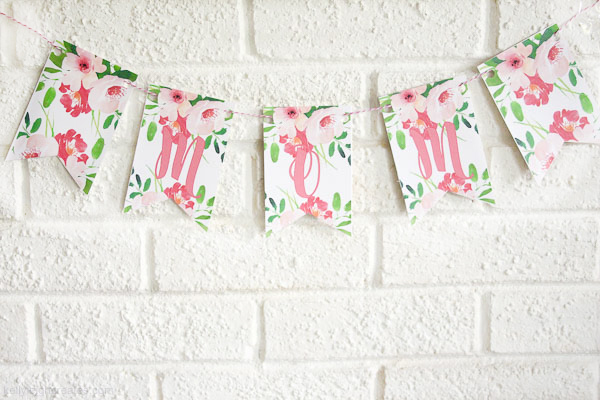 printable mother's day banner hanging on wall